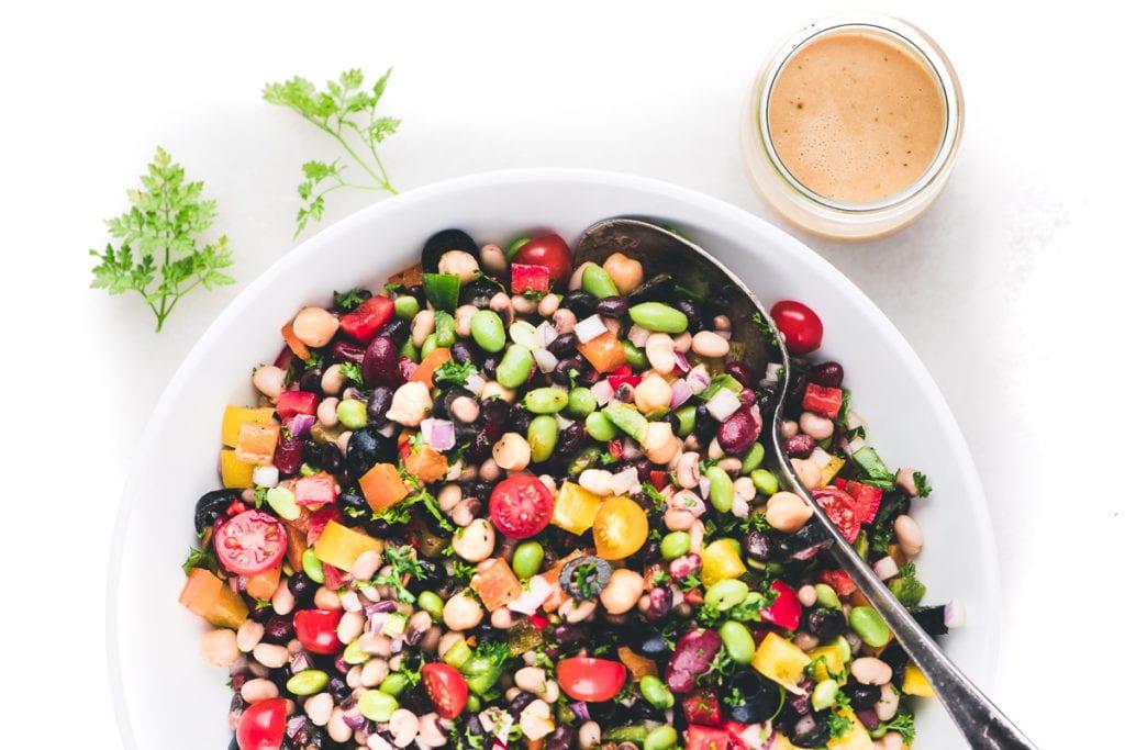 a bowl of rainbow bean salad