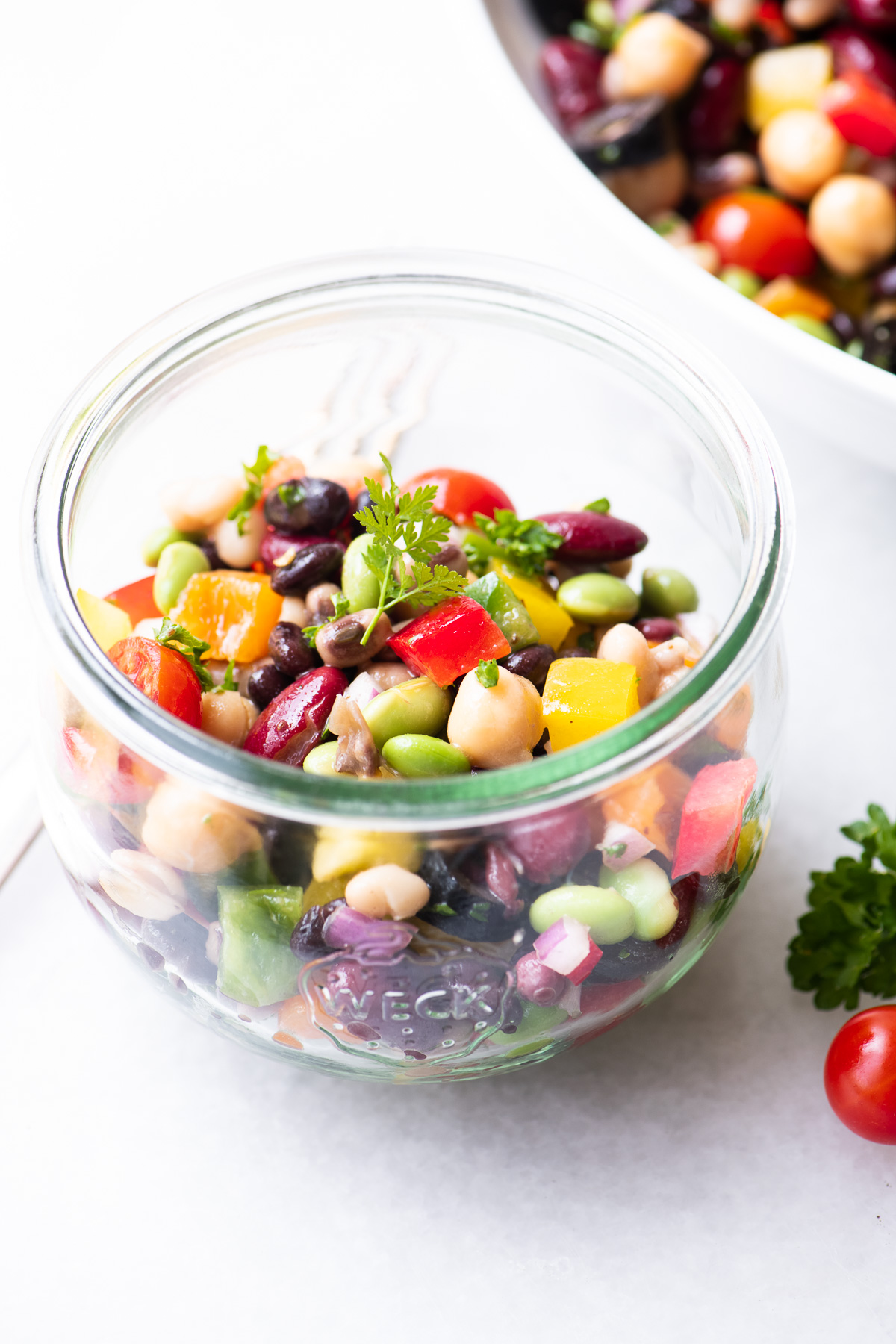 colorful rainbow bean salad in a glass jar
