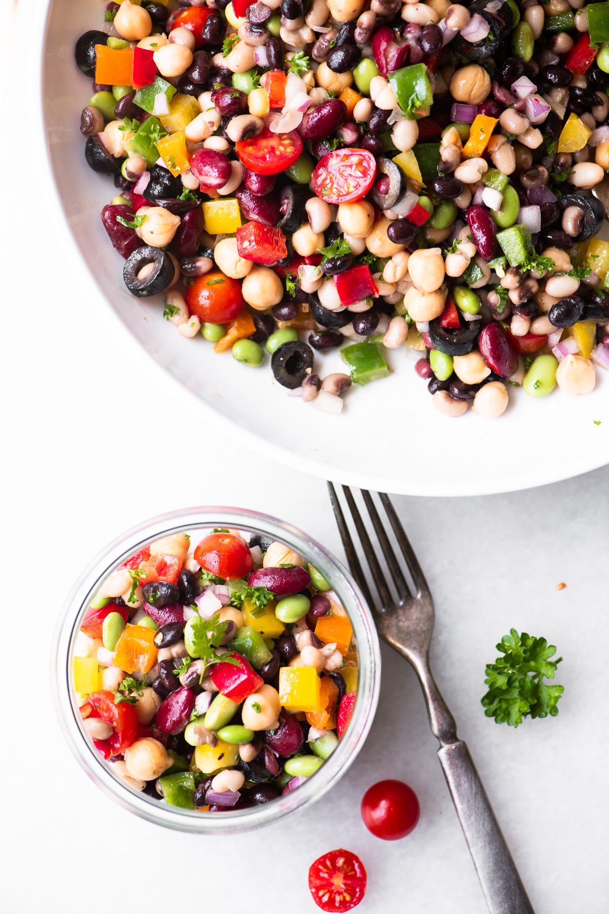 colorful rainbow bean salad on a white surface