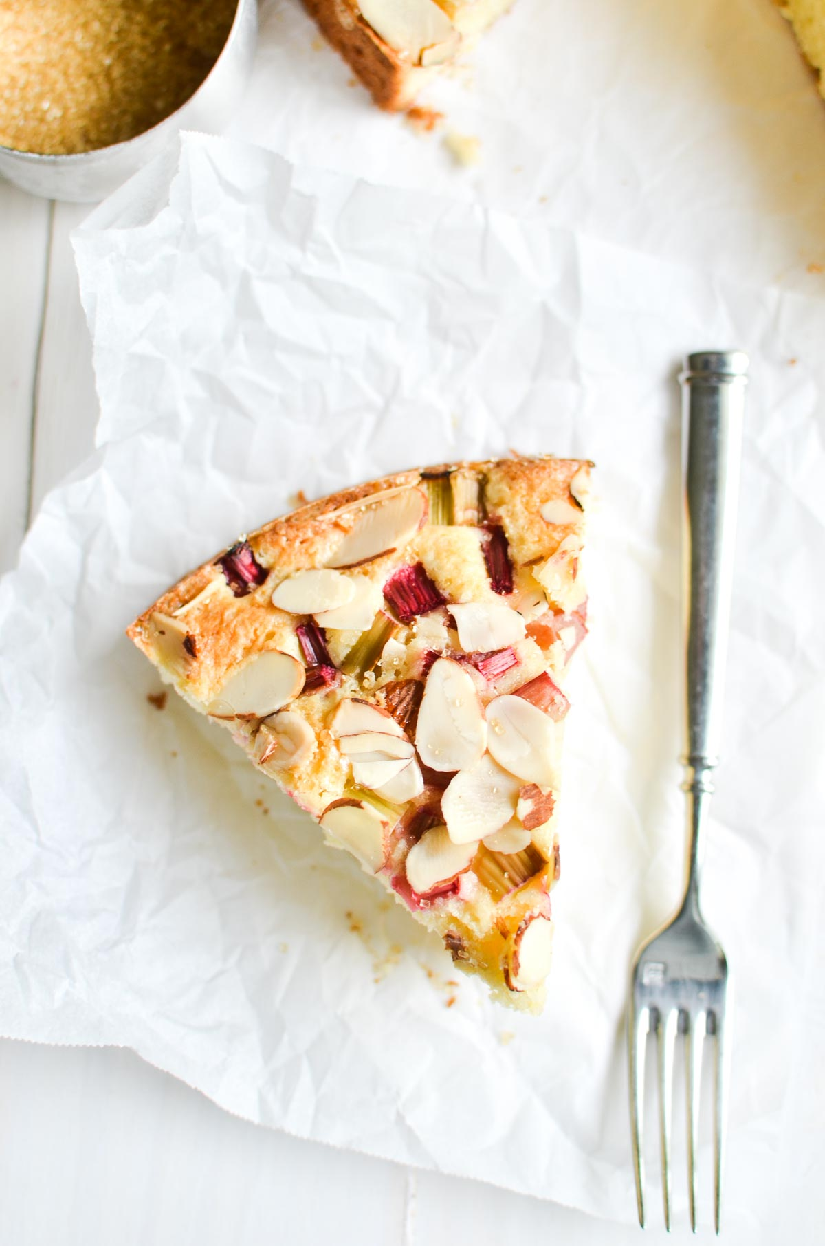 a slice of rhubarb and almond cake with fork