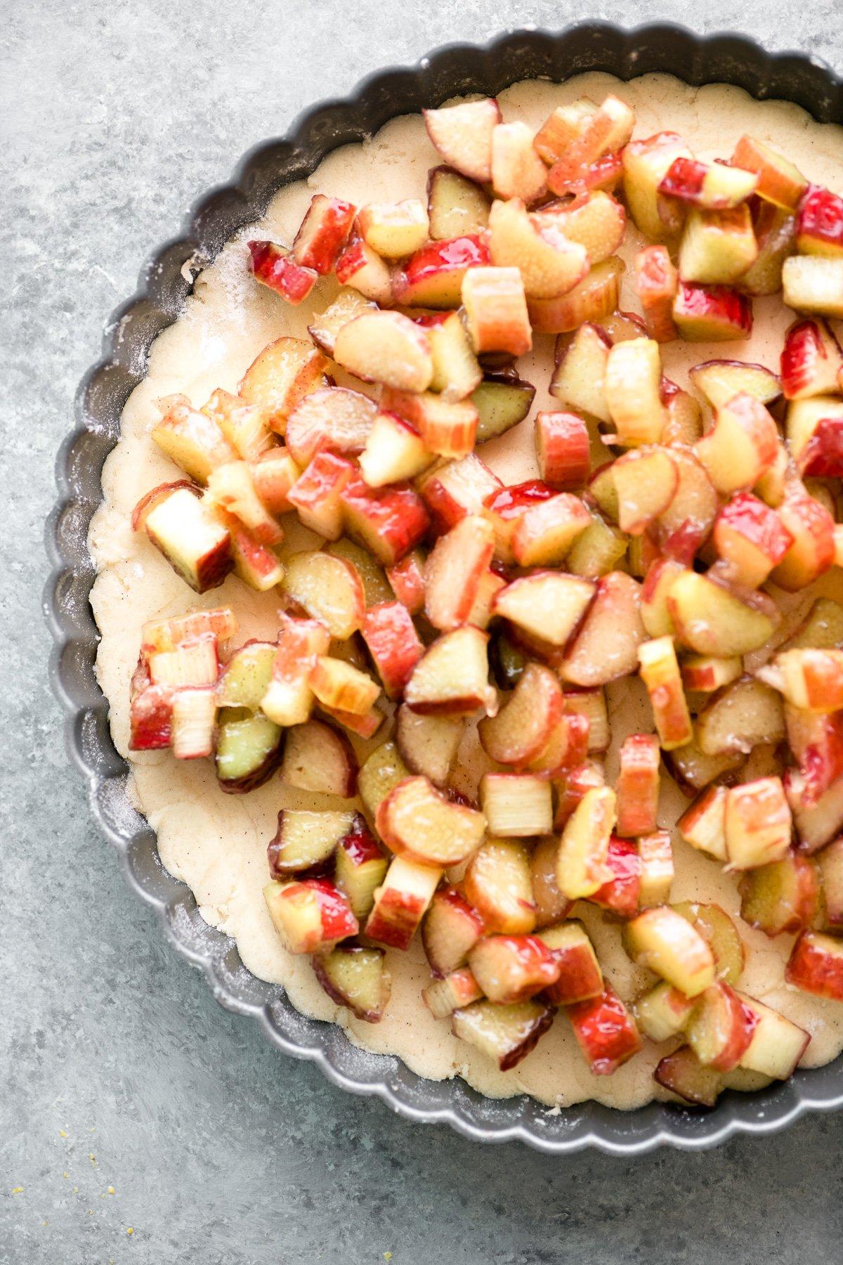 Assembling a rhubarb shortbread crumble tart