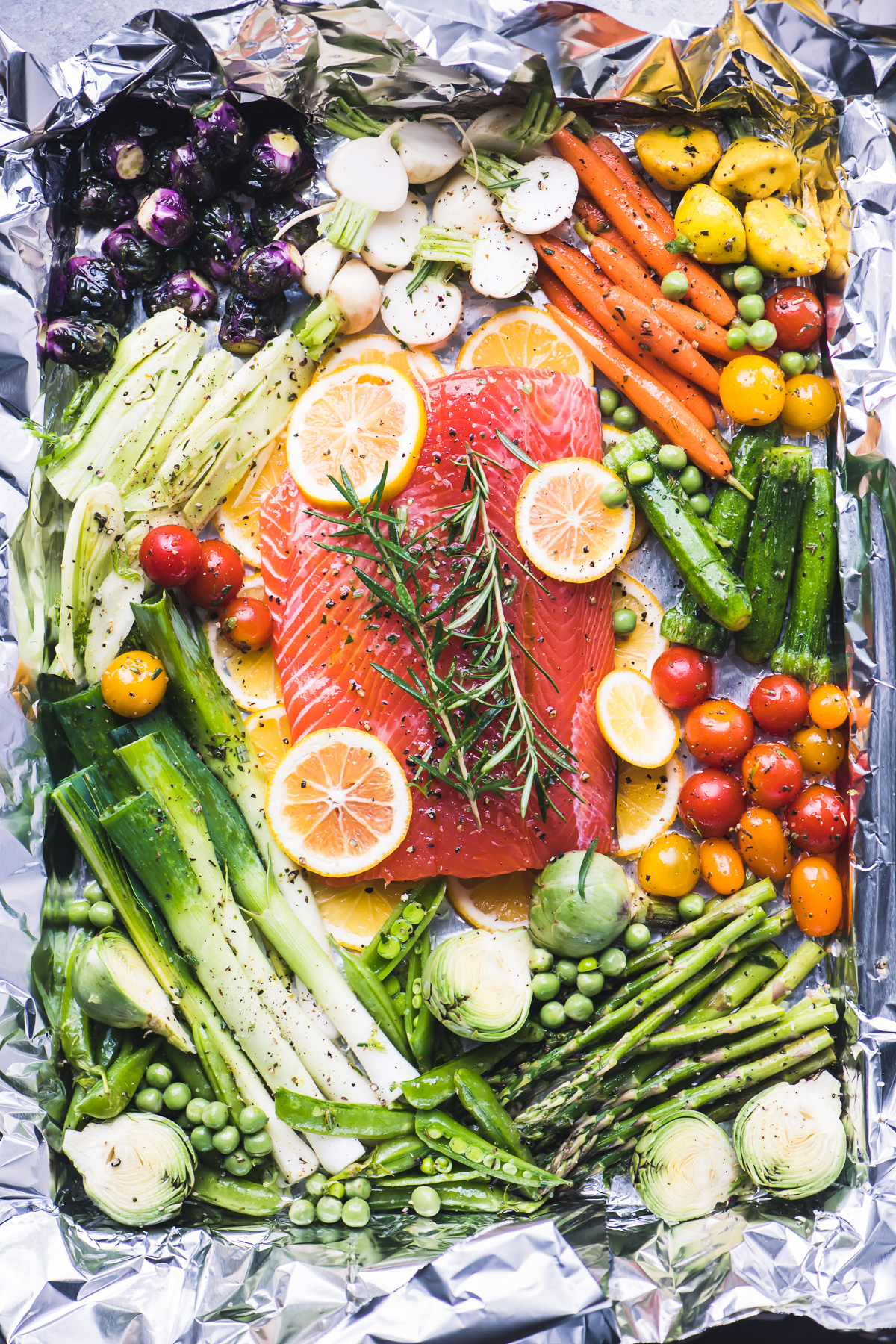 Sheet Pan Salmon Primavera on foil, ready for the oven
