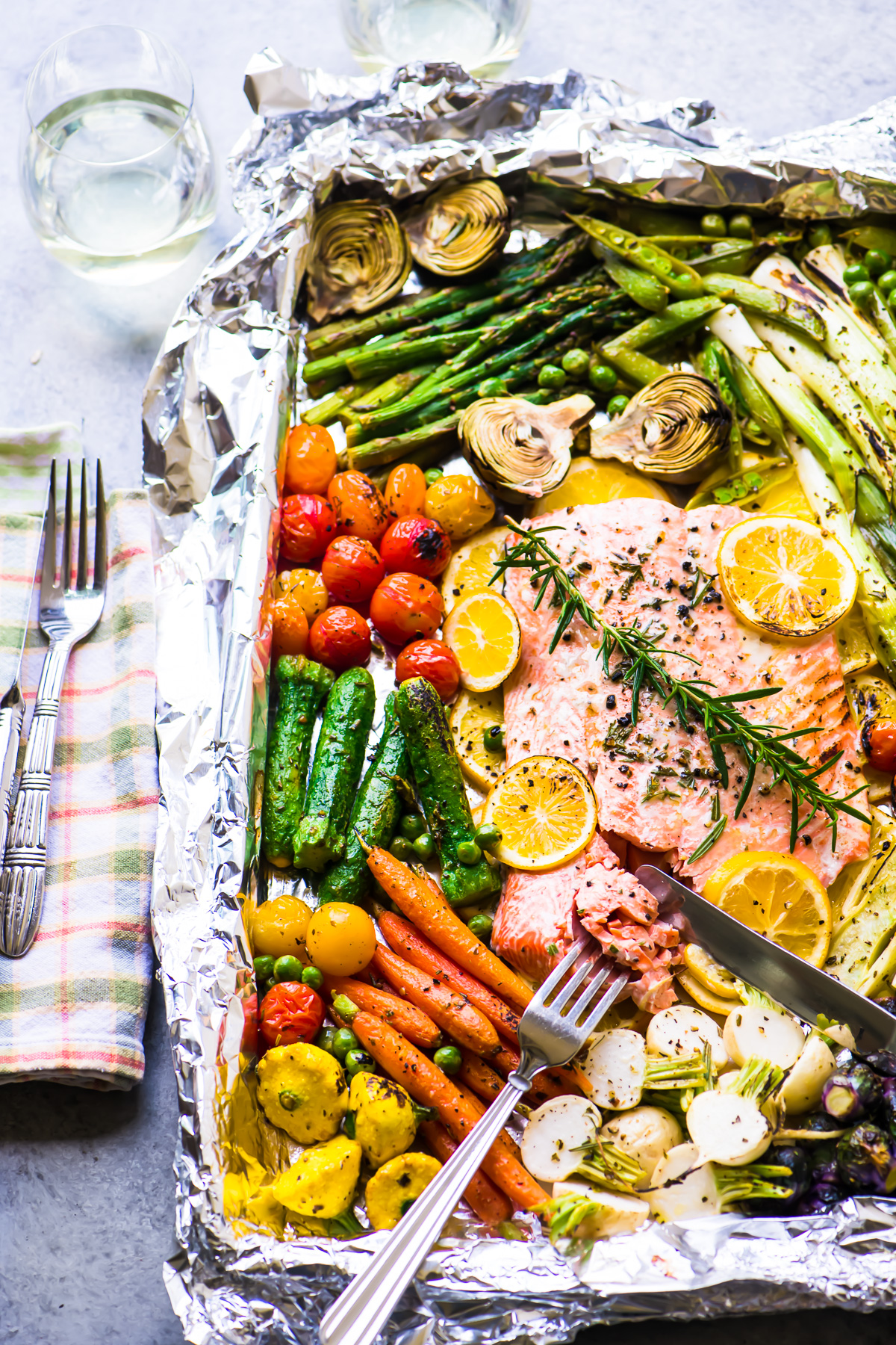 Sheet pan salmon primavera with fork and knife