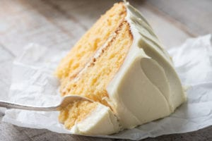 A big slice of Creamsicle Cake, with fork