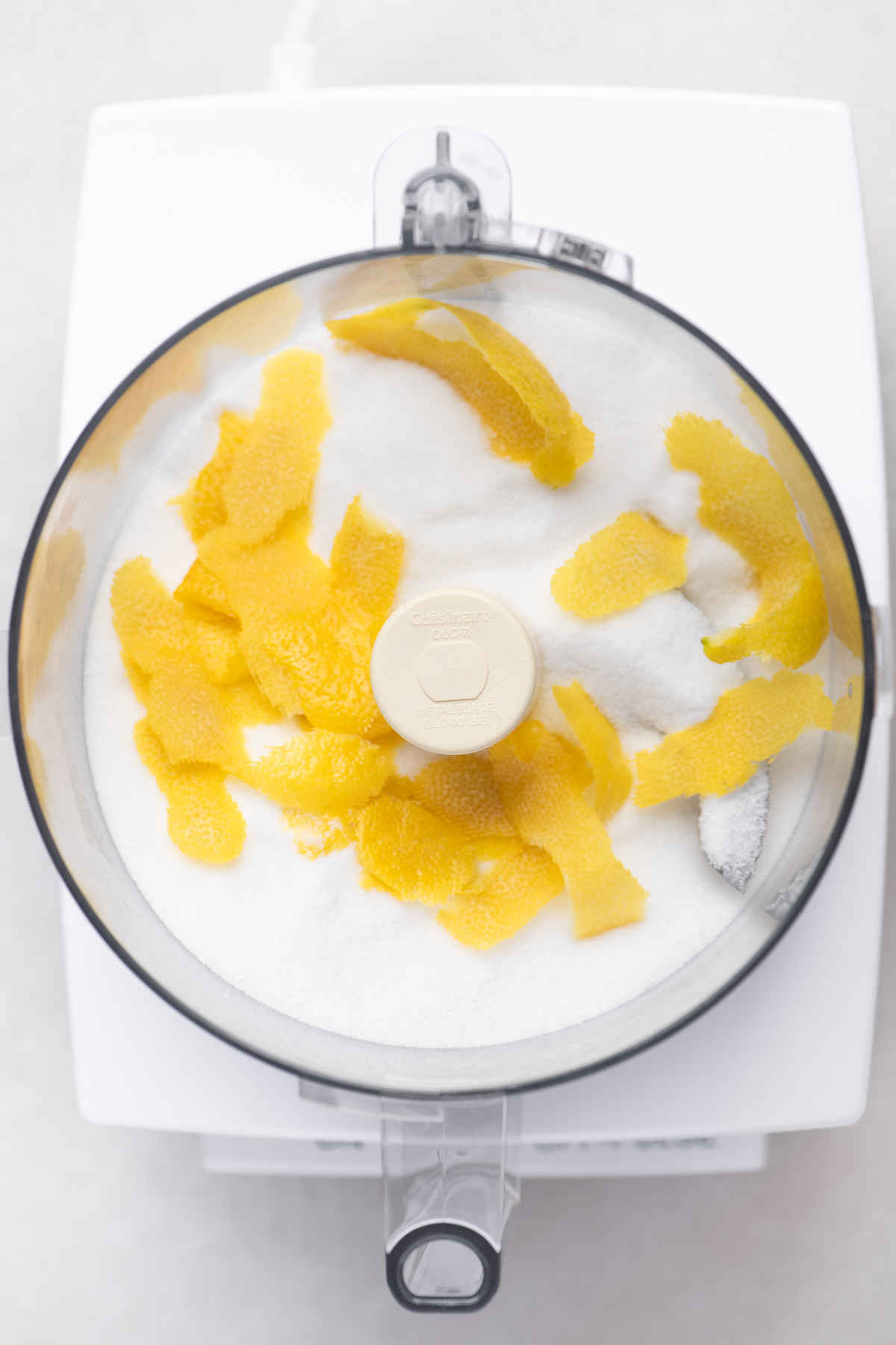 Making lemon sugar in a food processor