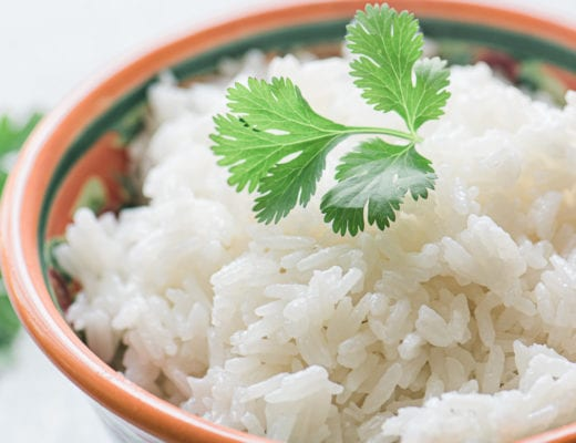 Coconut Rice with a sprig of cilantro