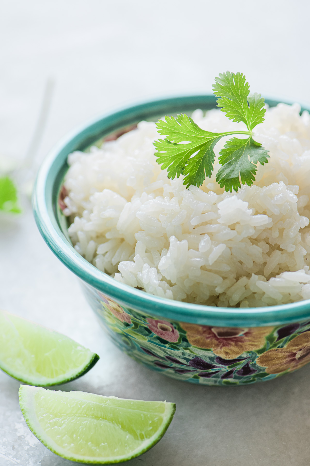 Coconut Rice in a bowl with cilantro and lime