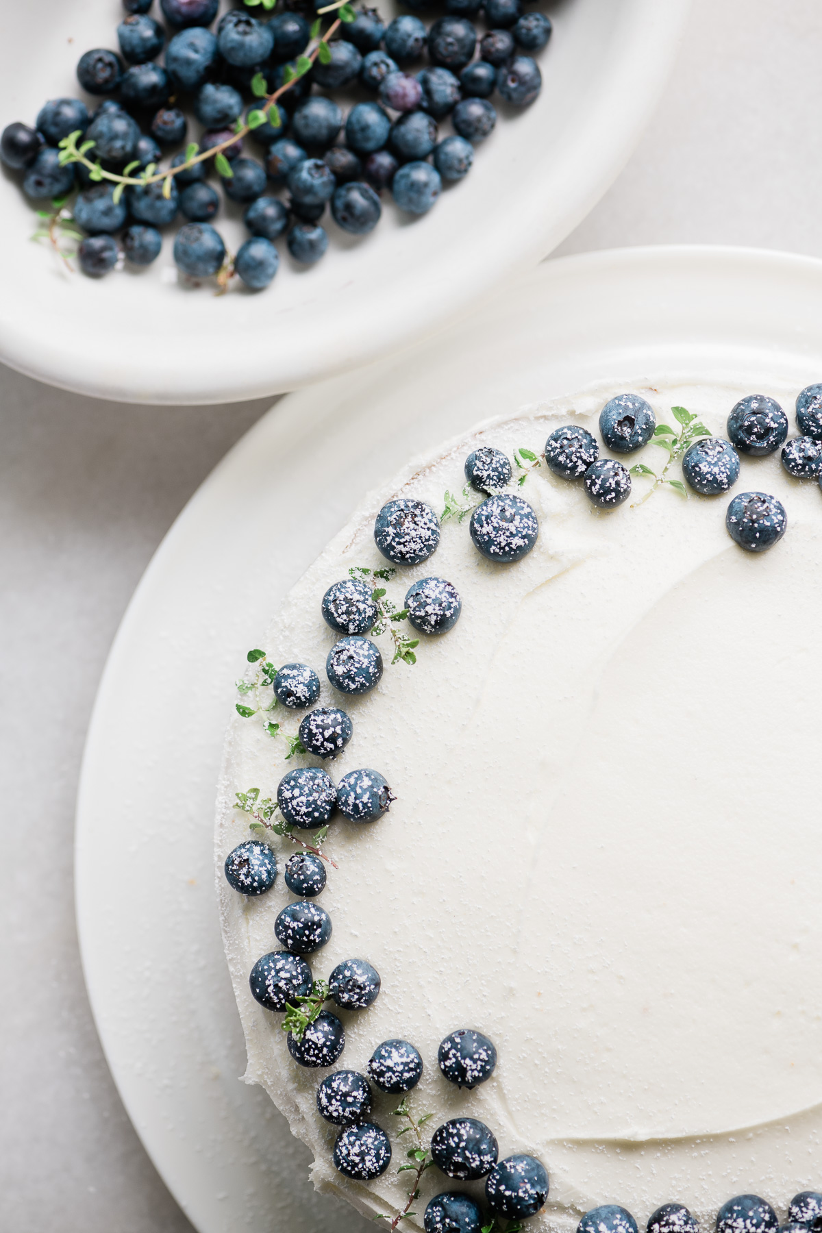 Blueberries decorating a blueberry lemon layer cake