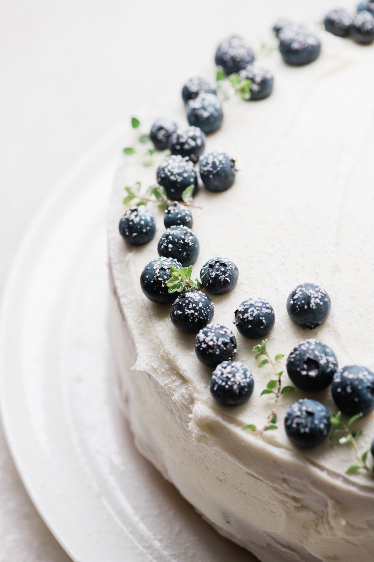 a blueberry lemon cake topped with fresh berries