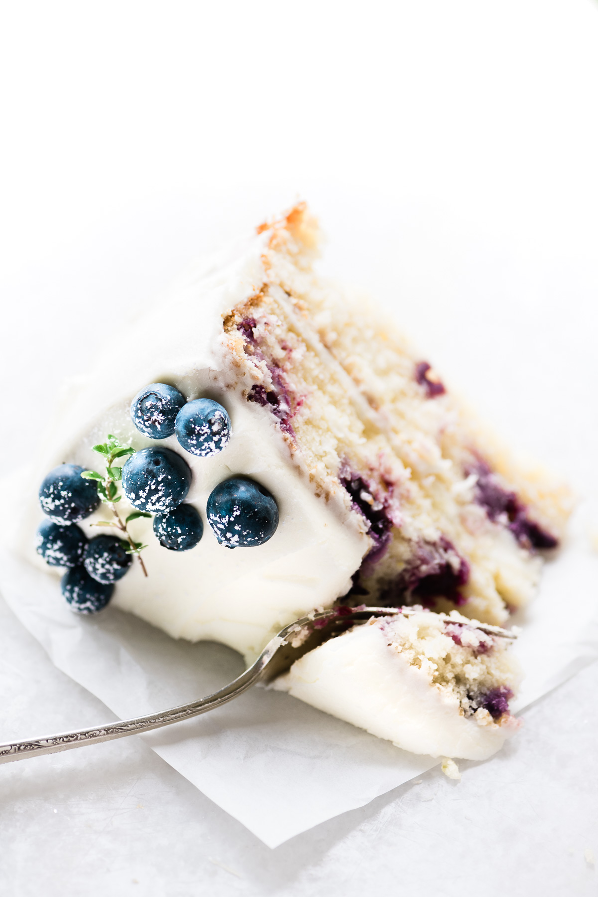 a slice of blueberry lemon layer cake