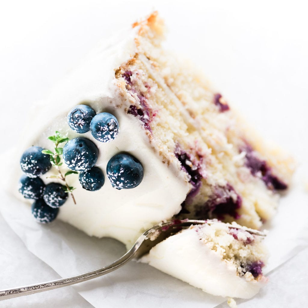 a slice of blueberry lemon cake