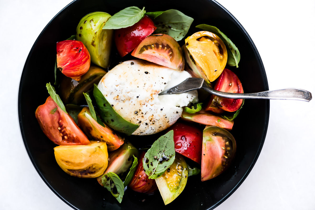 Burrata Caprese Salad with colorful heirloom tomato wedges