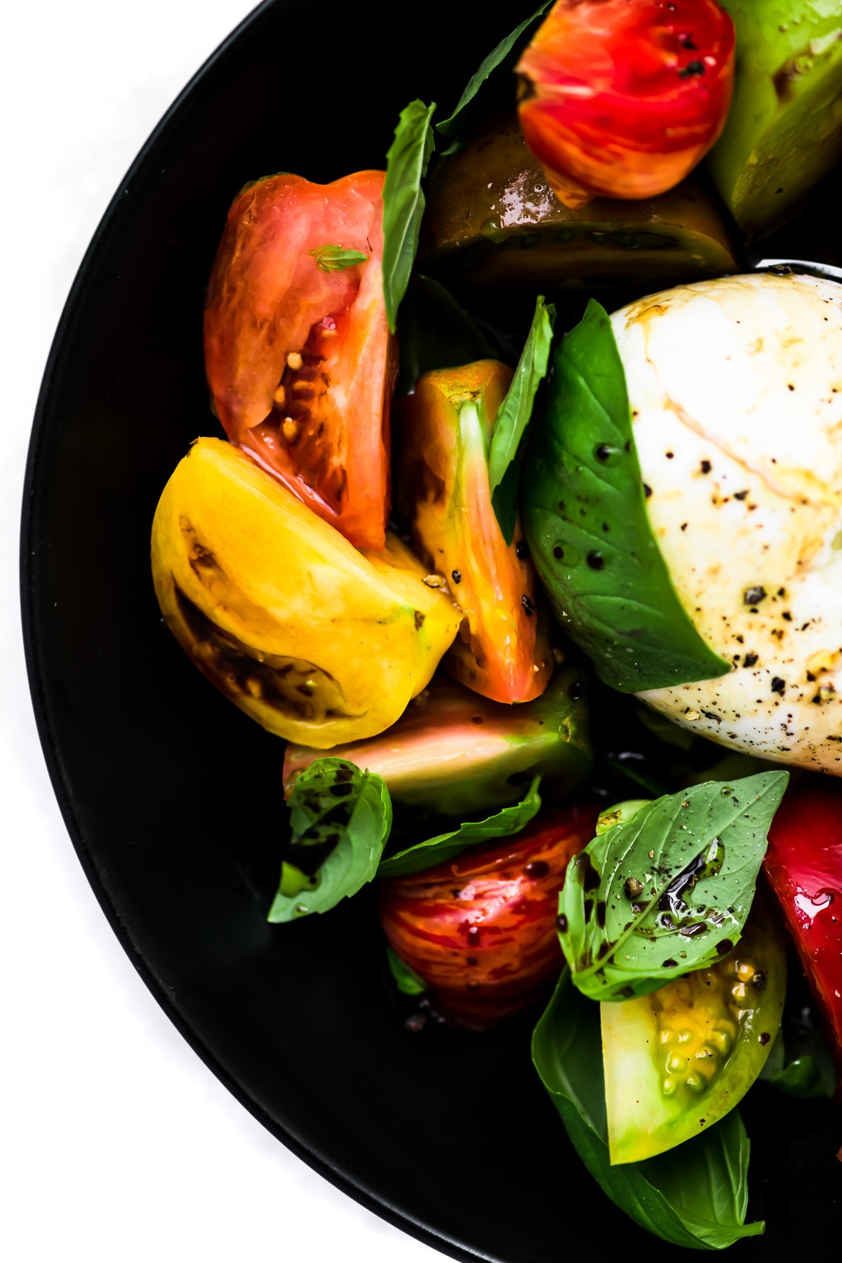 Burrata Caprese Salad with fresh basil leaves