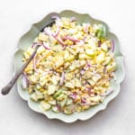 corn and cucumber salad in a green bowl