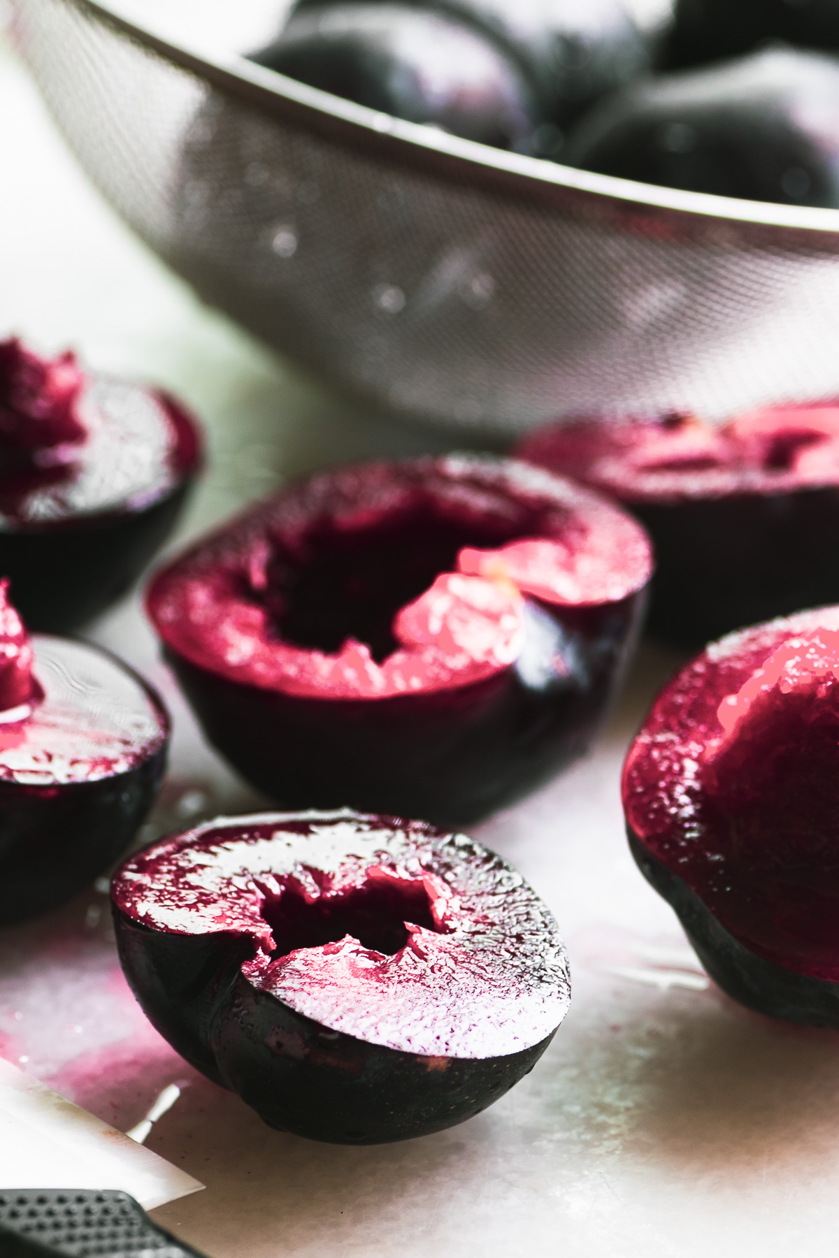 chopping plums for easy plum amaretto sorbet
