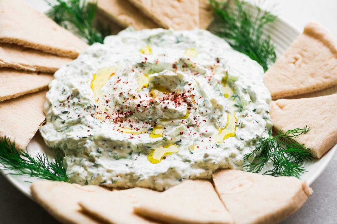Greek tzatziki dip with pita bread triangles