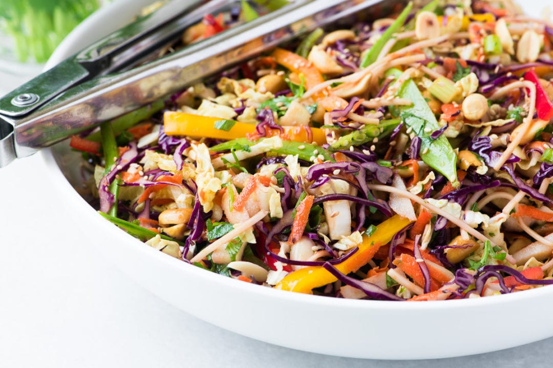 Colorful Asian Slaw with tongs