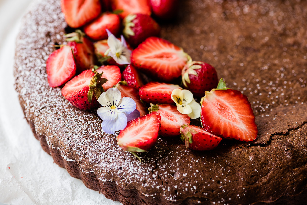 Mexican chocolate cake topped with berries