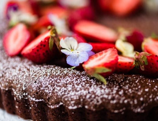 Mexican chocolate cake topped with strawberries