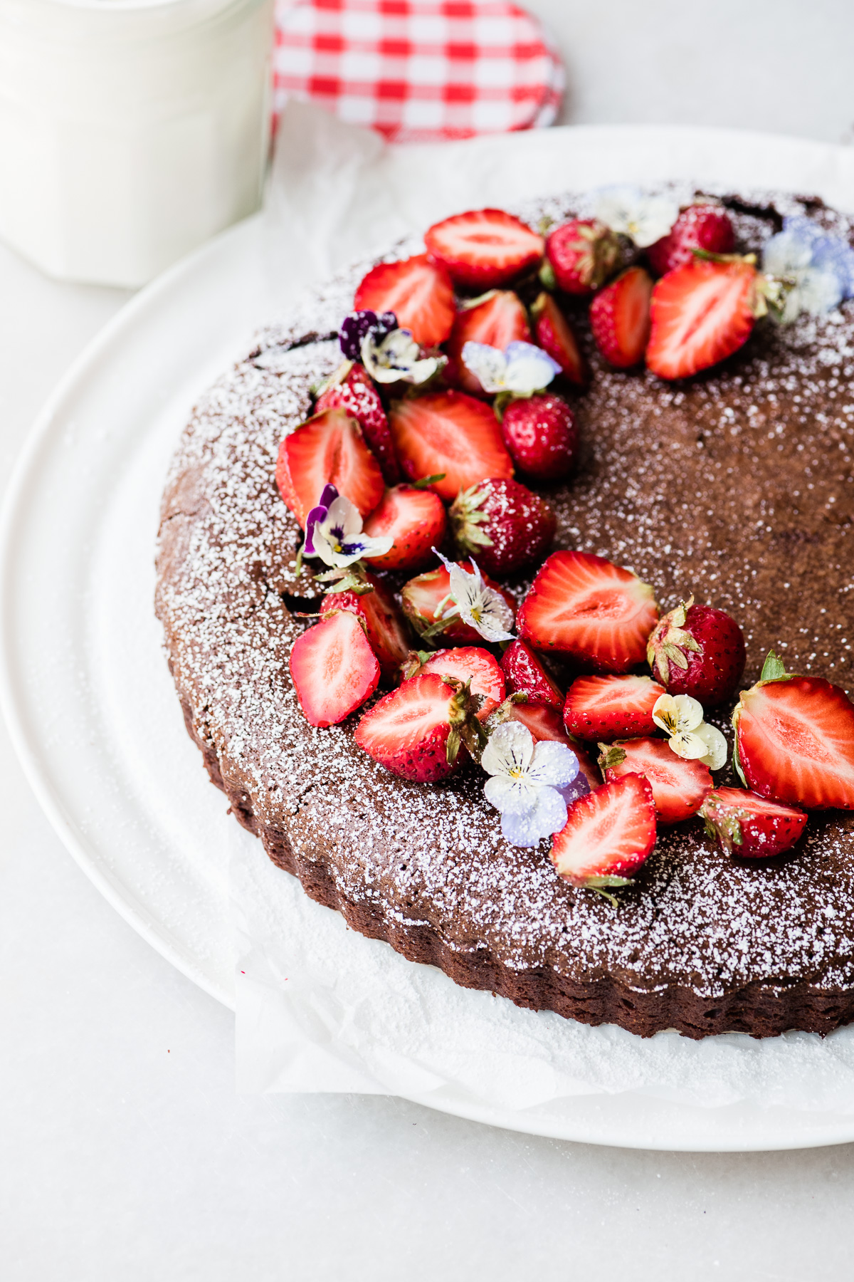 Mexican Chocolate Cake with strawberries and pansies
