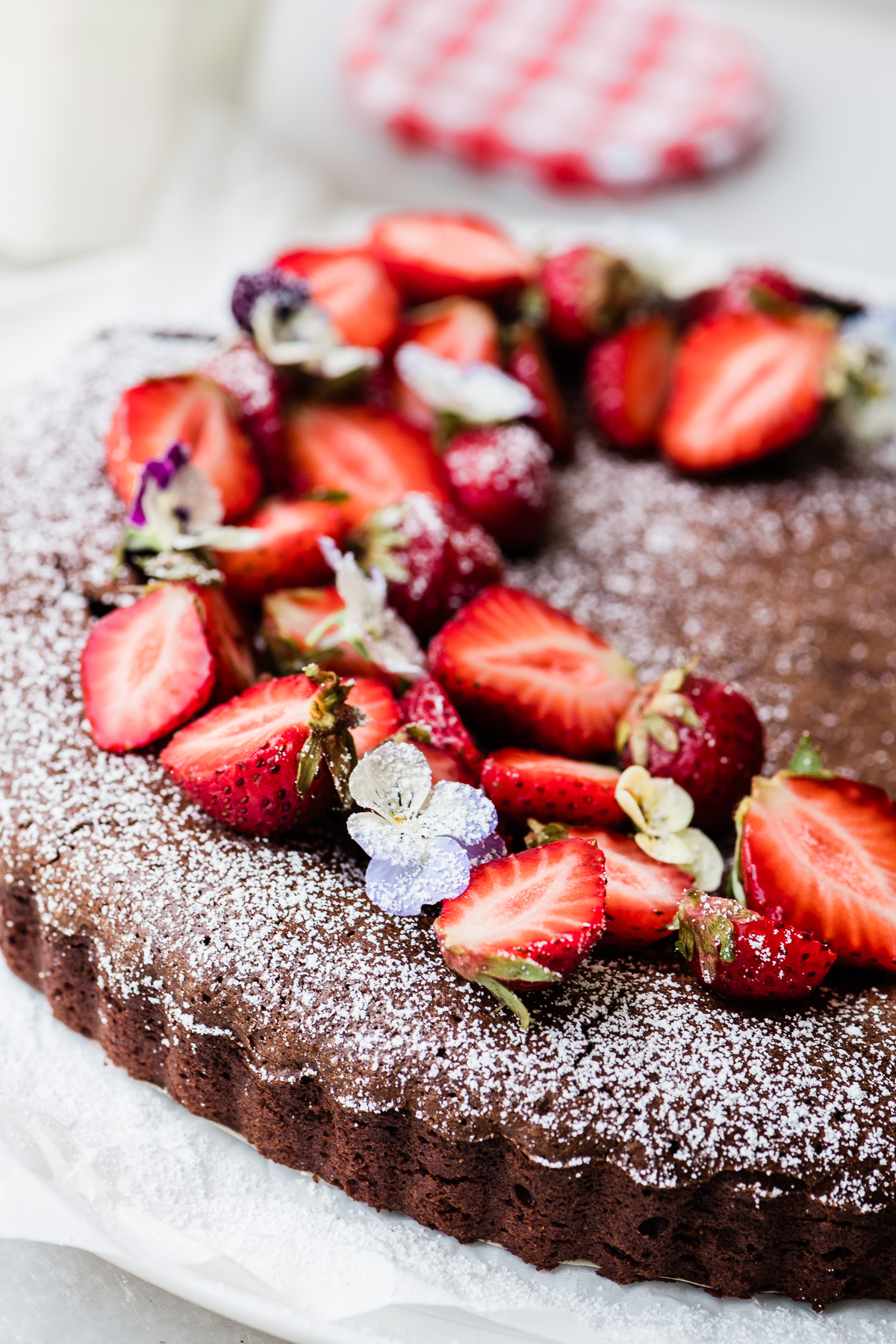 Mexican Chocolate Cake with powdered sugar and strawberries