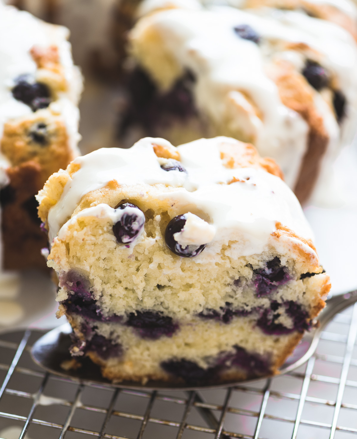 a slice of blueberry muffin bundt cake