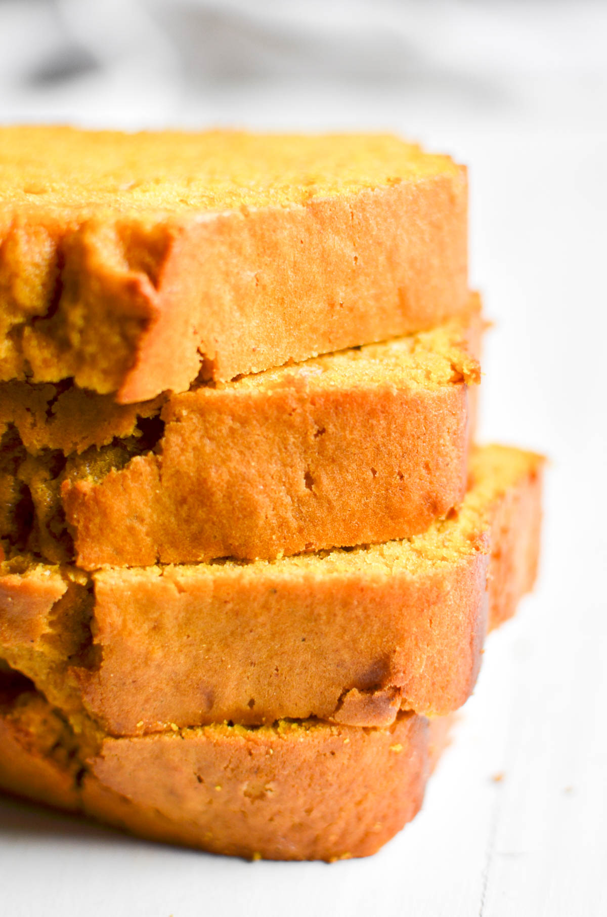 stacked slices of easy one bowl pumpkin bread