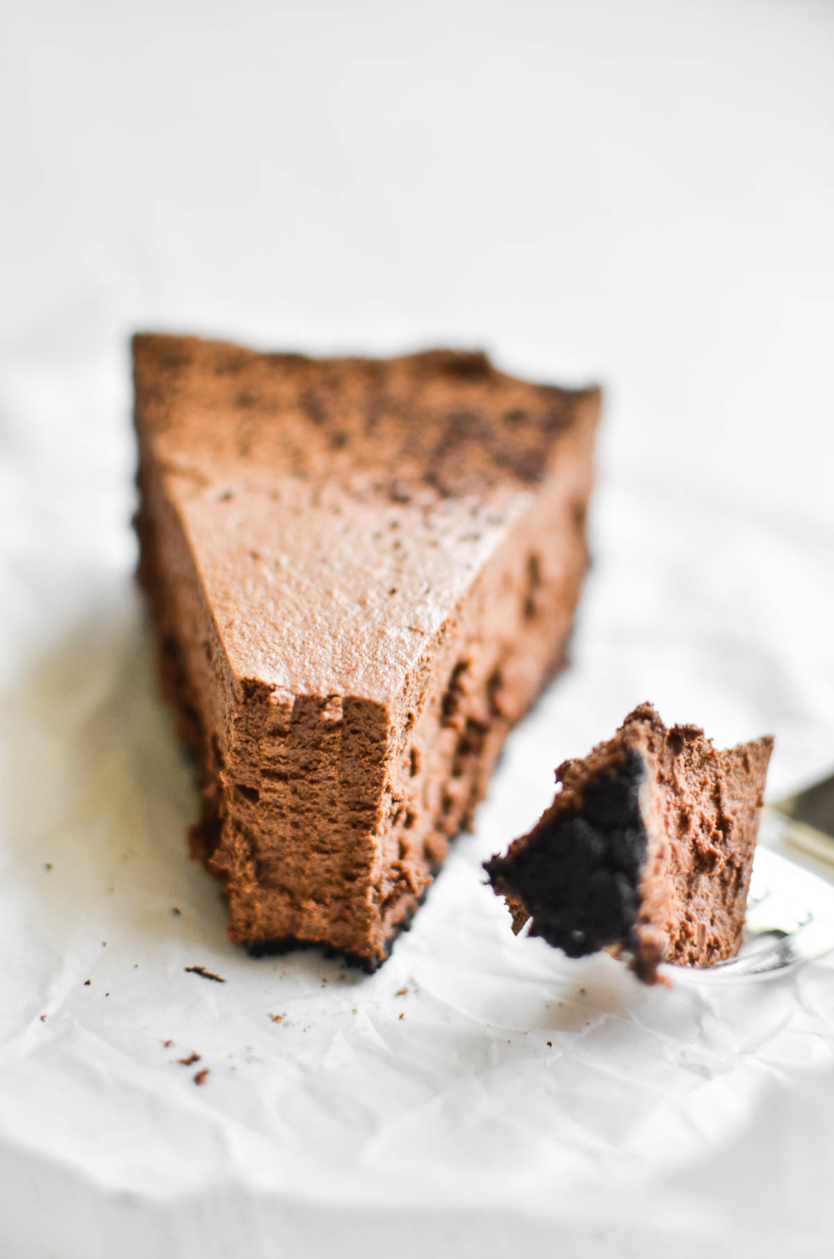 a piece of almost no bake chocolate mousse pie with bite taken