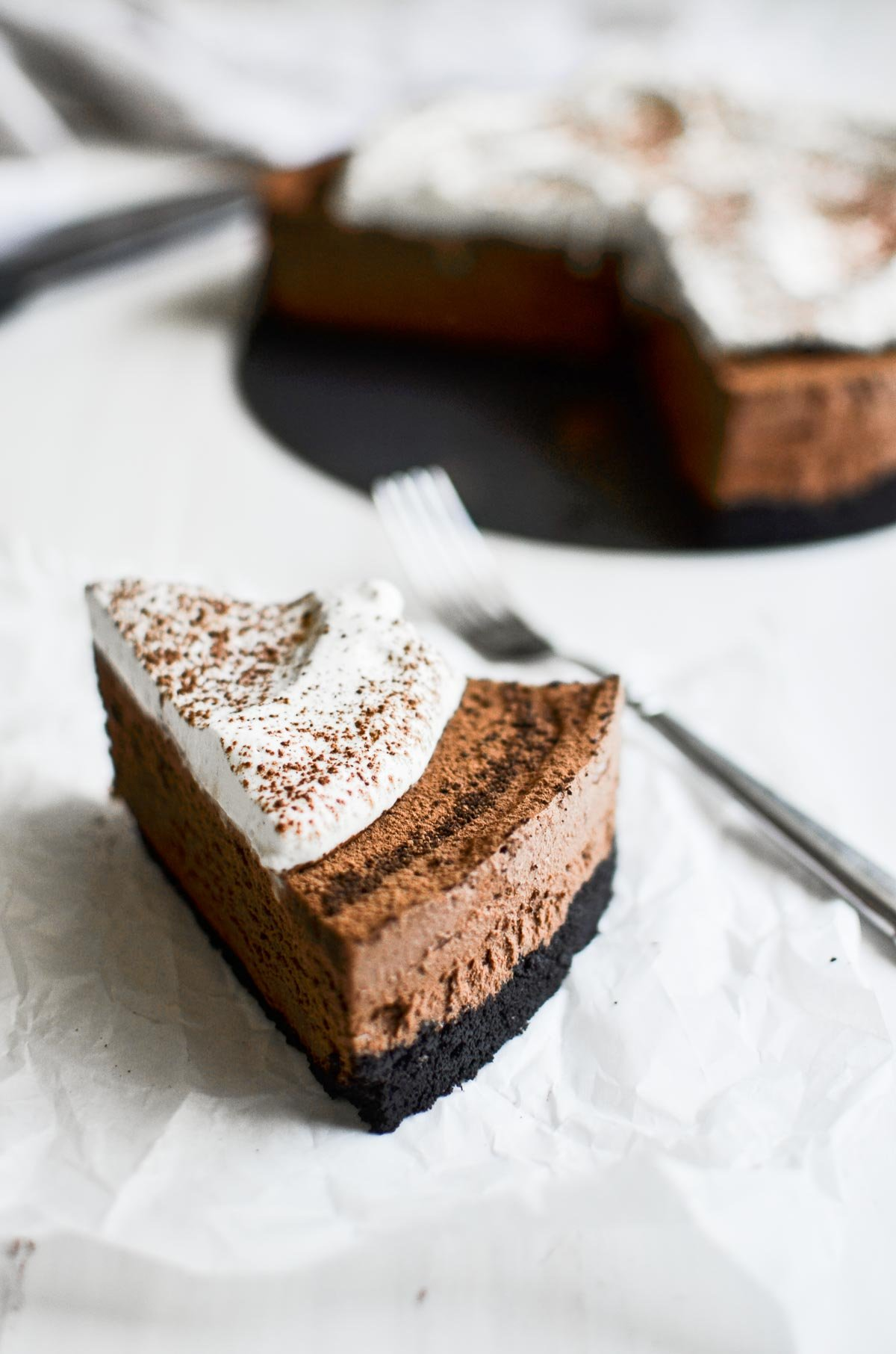 a slice of (almost) no bake chocolate mousse pie with fork