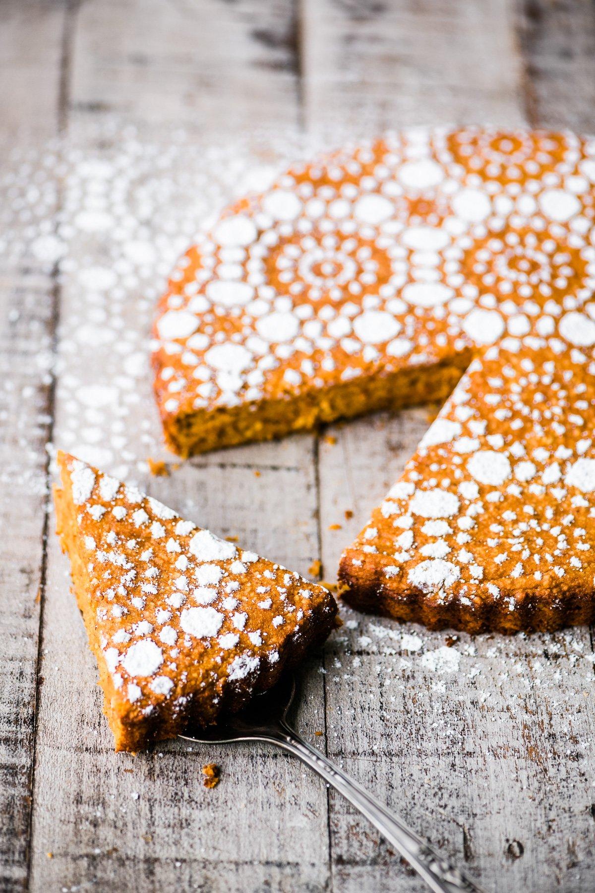 a flourless pumpkin spice cake on a wooden board