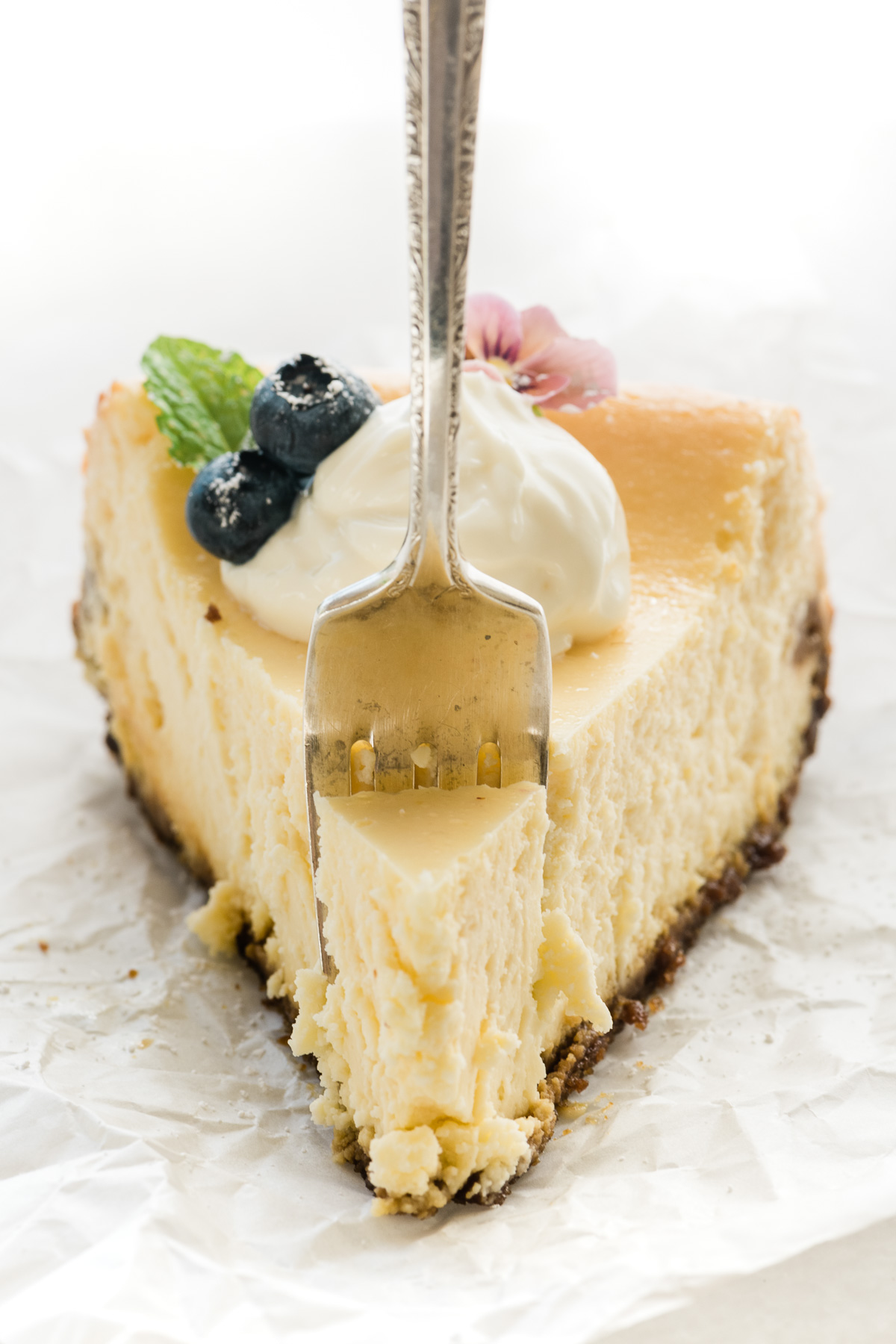 A slice of lemon cheesecake with fork