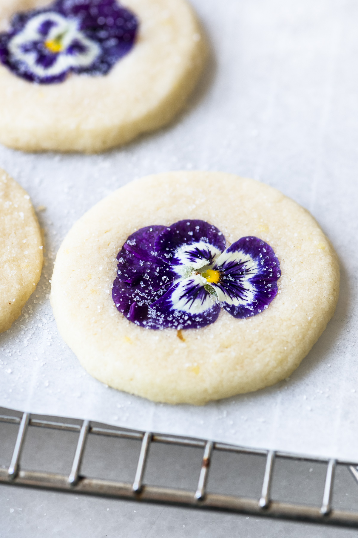 edible flower topped shortbread cookies, cooling