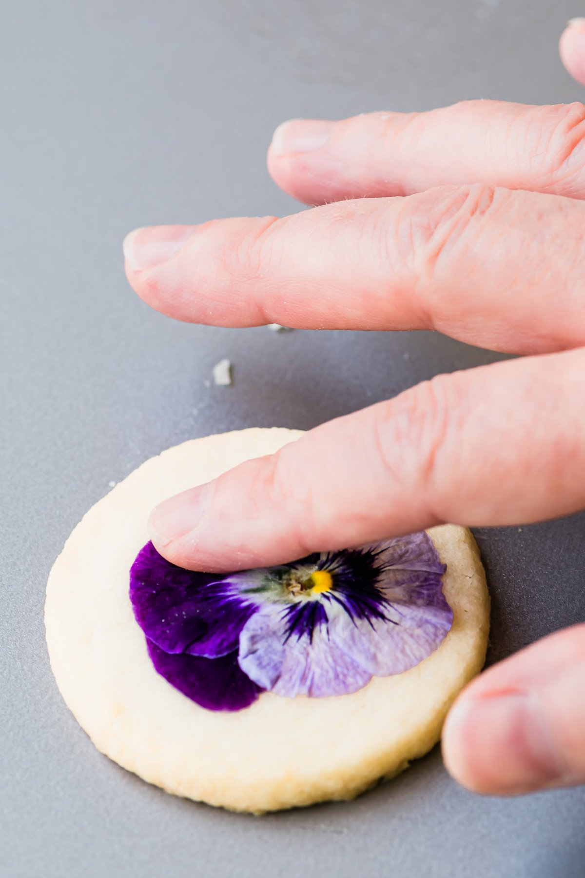 making edible flower cookies with fresh pansies
