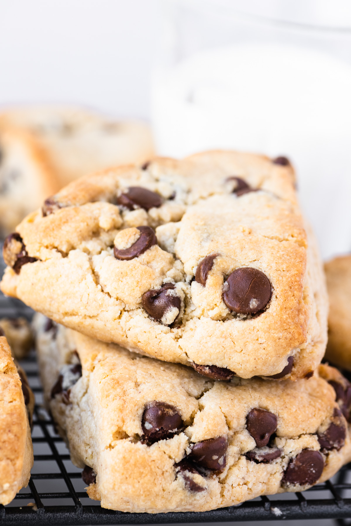 a stack of peanut butter chocolate chip scones with a glass of milk