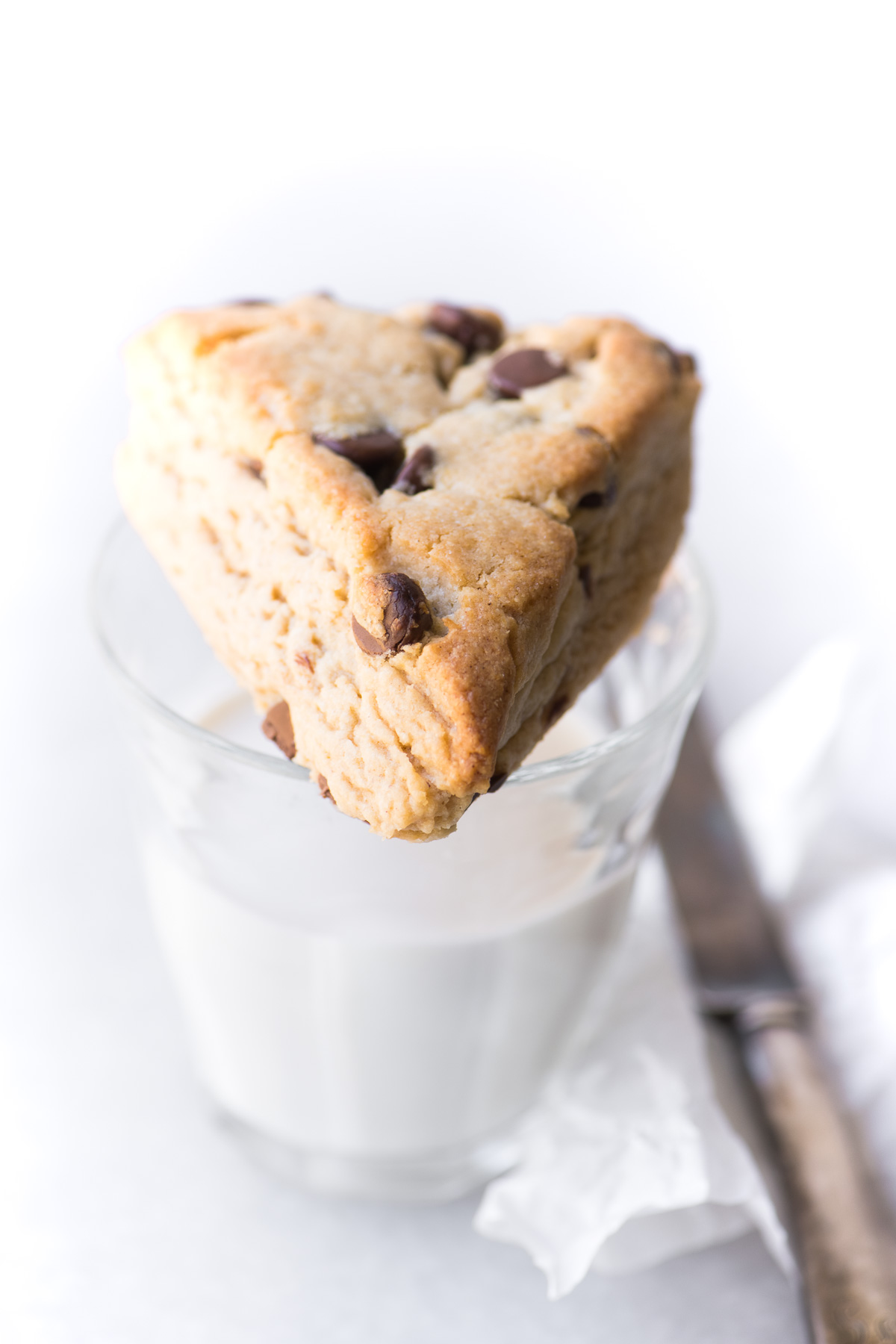 peanut butter chocolate chip scone on a glass of milk
