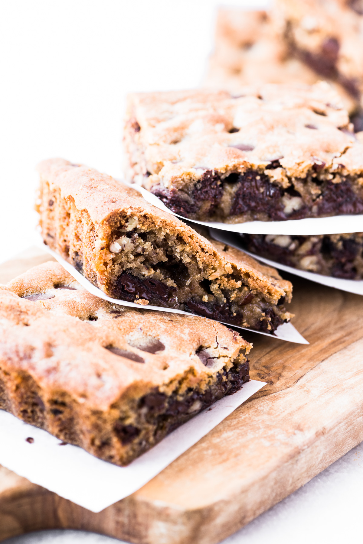 A stack of pecan and chocolate chip blondies