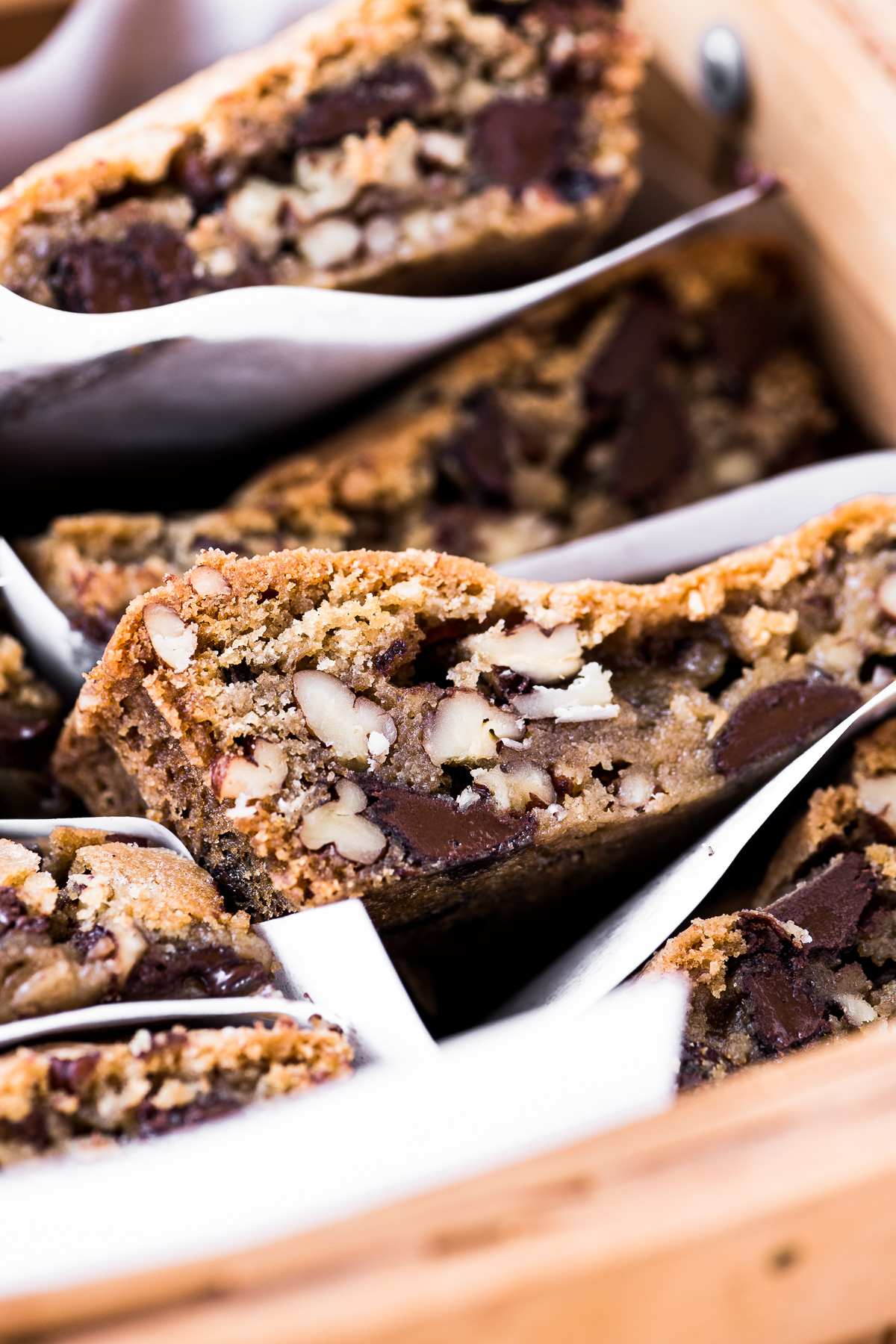 dark chocolate pecan blondies packed for a picnic
