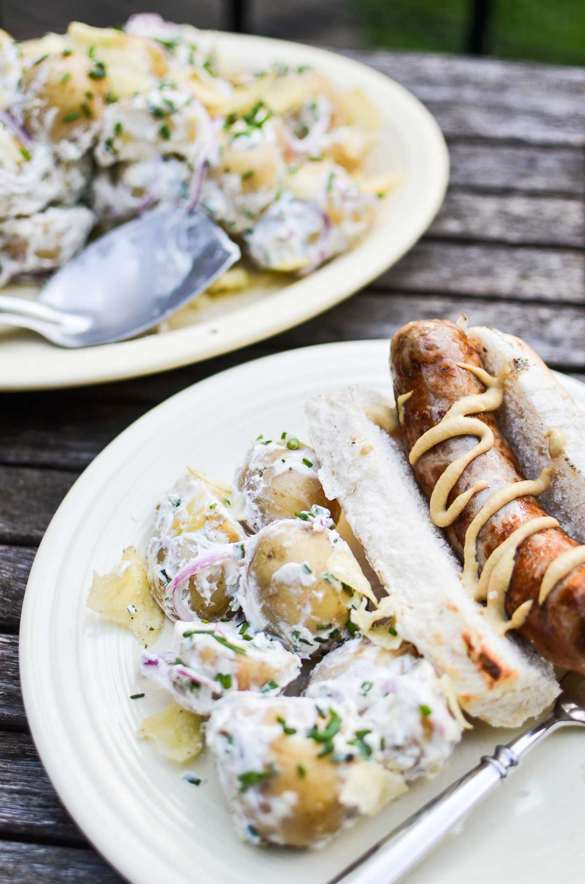 sour cream and onion potato salad with a grilled brat