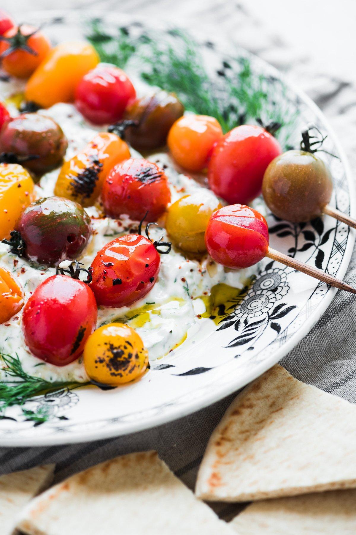 tzatziki with burst tomato skewers