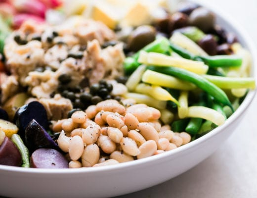 Tossed Salad Nicoise in a white bowl
