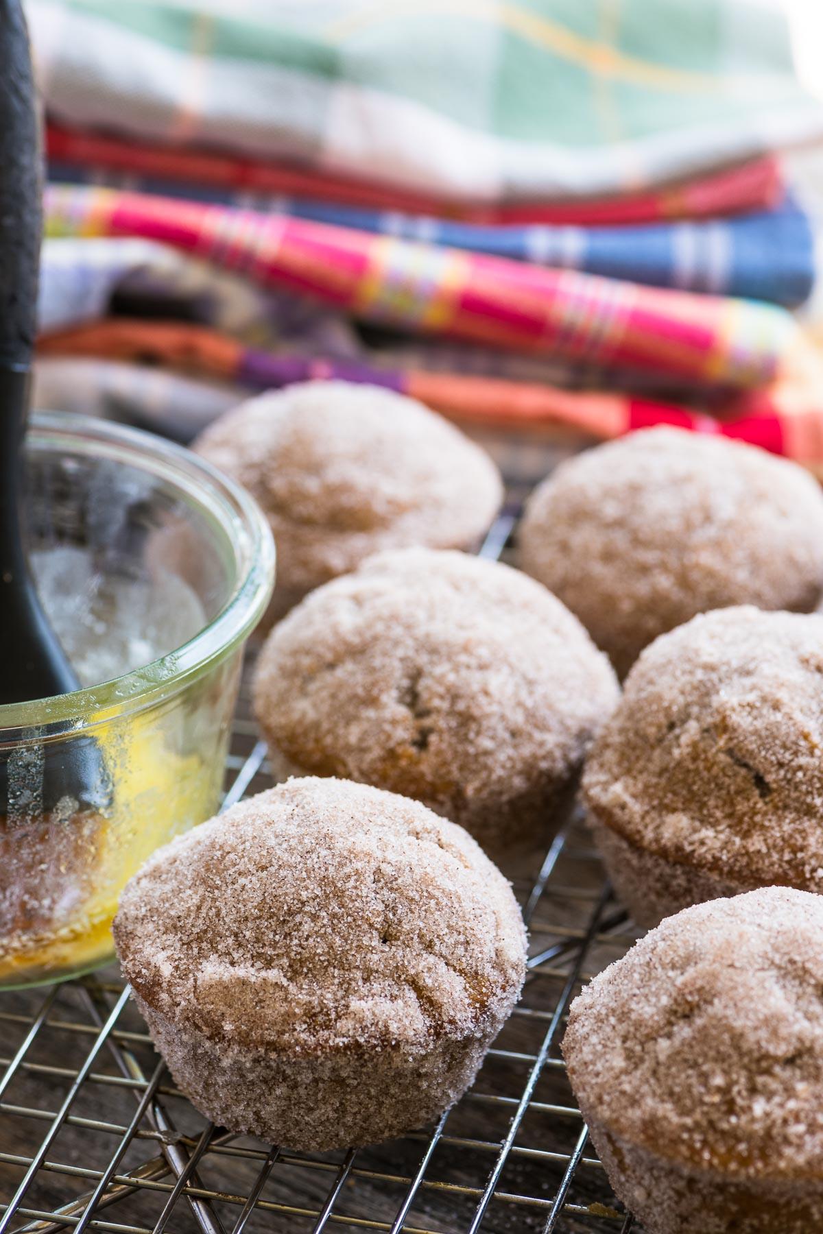 apple cider doughnut muffins on a cooling rack