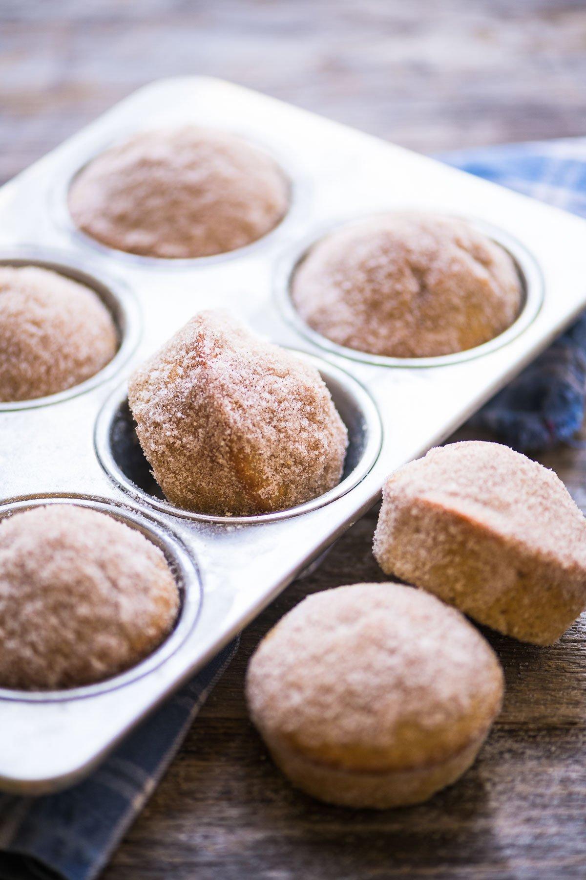 cider doughnut muffins in a muffin tin
