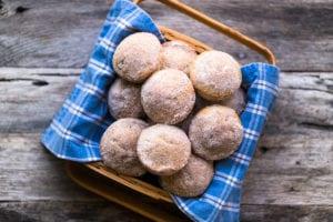 apple cider doughnut muffins in a basket