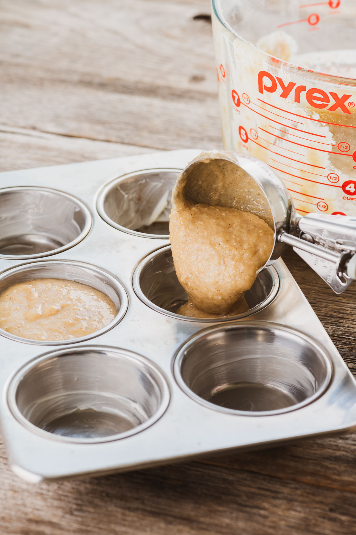 filling muffin tins for apple cider doughnut muffins
