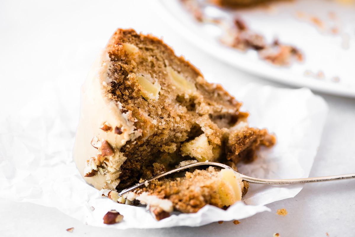 bite shot of a piece of caramel apple bundt cake