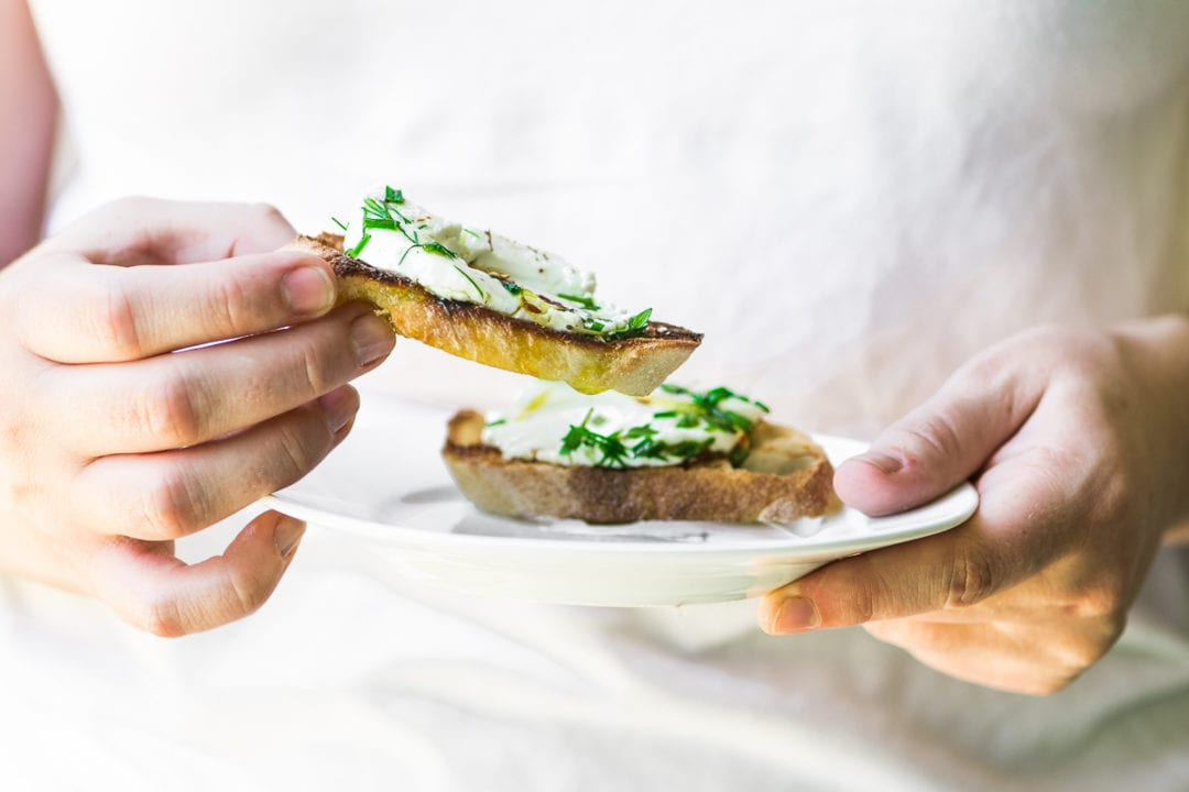 herb marinated goat cheese on slices of toasted bread
