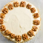 a maple pumpkin cake topped with walnuts