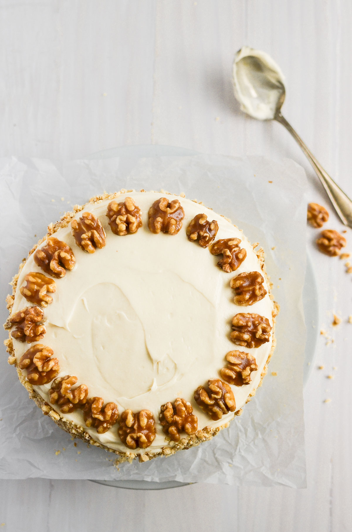 a maple walnut layer cake topped with walnut halves