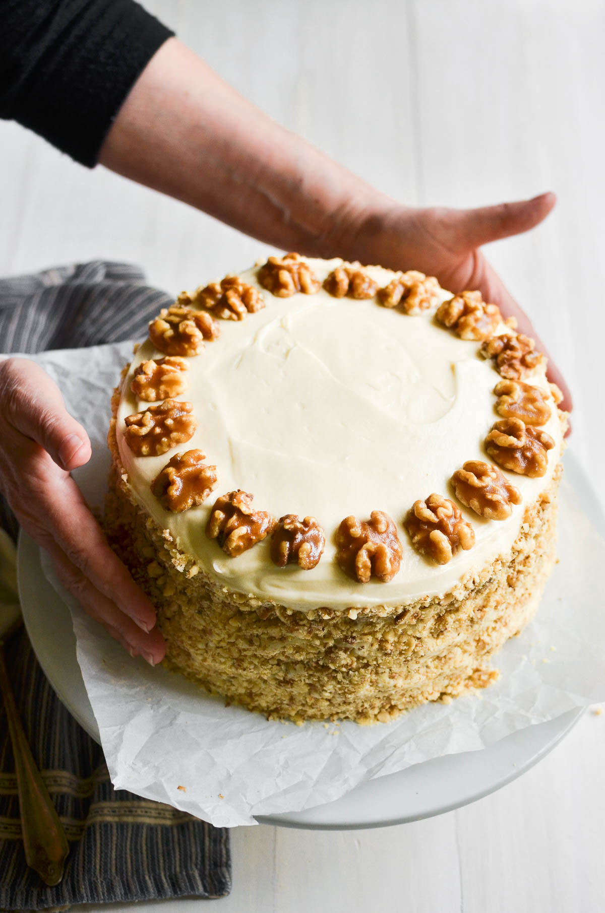 a maple walnut cake topped with candied walnuts