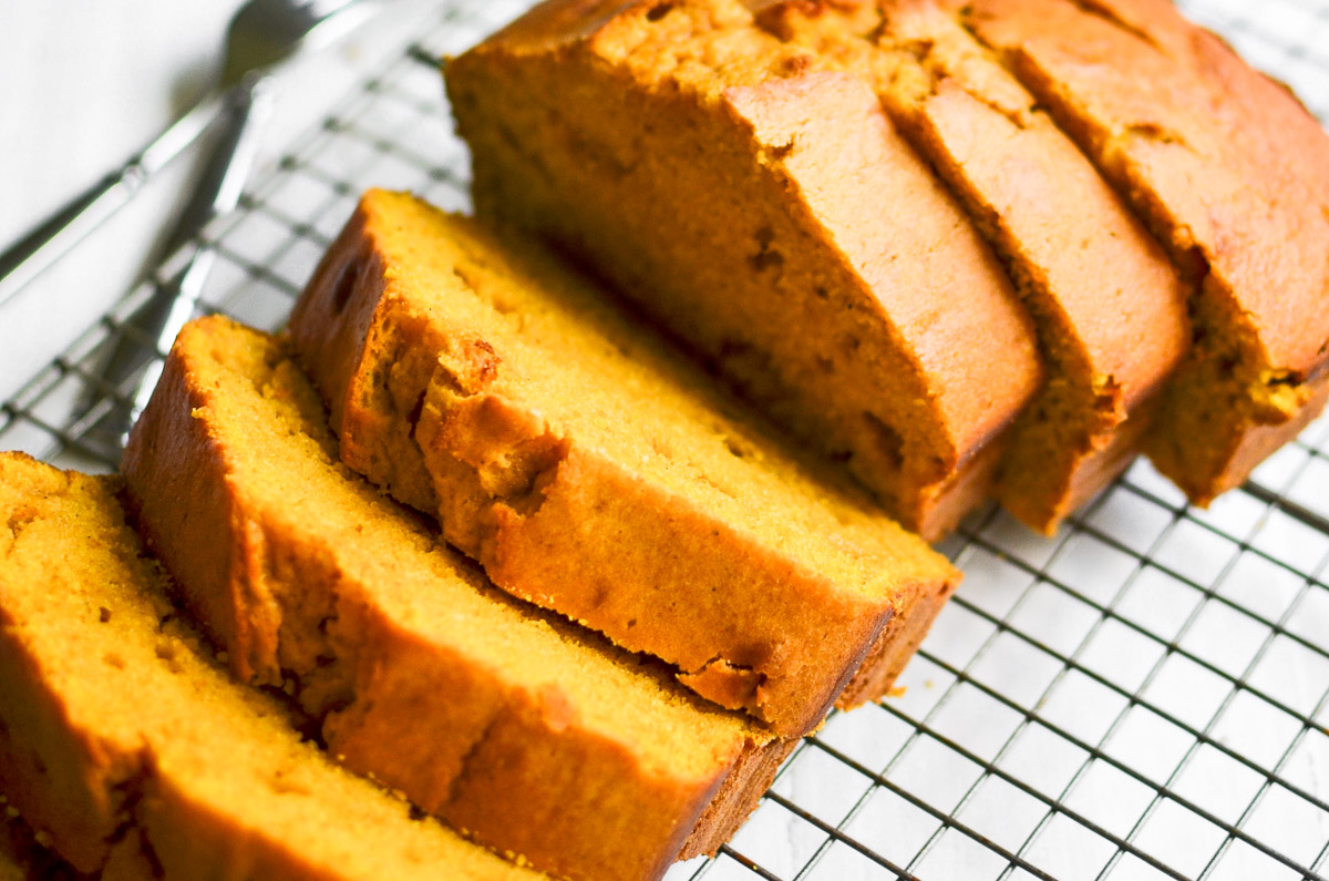 sliced pumpkin bread, on a cooling rack
